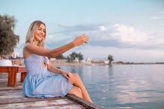 Girl making selfie on the beach stock photos