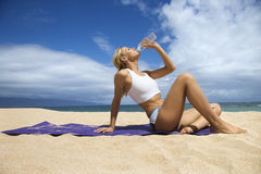 Attractive Young Woman Drinking on Beach Stock Photos