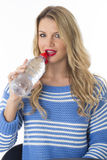 Attractive Young Woman Drinking a Bottle of Still Mineral Water Stock Image
