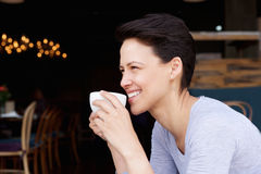 Attractive young woman drinking coffee at cafe Stock Photography