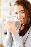 Attractive young woman drinking coffee at home Royalty Free Stock Image
