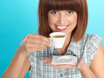 Attractive young woman drinking an espresso coffee Stock Photography