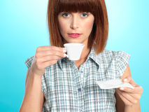 Attractive young woman drinking an espresso coffee Royalty Free Stock Photos