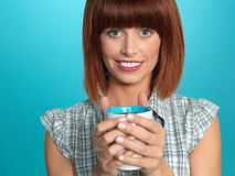 Attractive young woman drinking her morning coffee Stock Images
