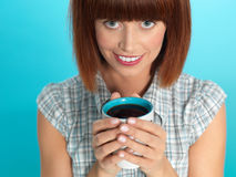 Attractive young woman drinking her morning coffee Royalty Free Stock Photography