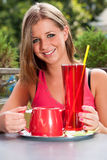 Attractive young woman drinking ice tea outdoor Royalty Free Stock Image