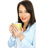 Attractive Young Woman Drinking a Mug of Coffee Royalty Free Stock Photos