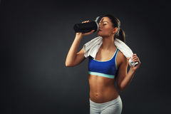 Attractive young woman drinking proteins Stock Images