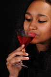 Attractive young woman drinks cocktail Royalty Free Stock Photos