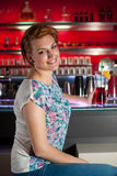Attractive young woman drinks ice tea in  bar Stock Photo