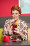 Attractive young woman drinks icetea Stock Images