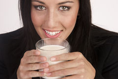 Attractive Young Woman Drinks Whole Milk From a Glass Stock Images