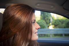 Attractive young woman driving car Royalty Free Stock Photography