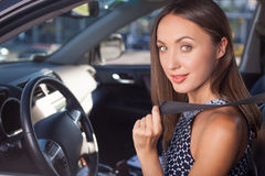 Attractive young woman is driving vehicle with Stock Photos