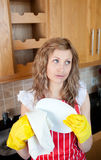 Attractive young woman drying dishes Royalty Free Stock Photography