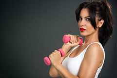 Attractive young woman  with dumbbells Royalty Free Stock Photo
