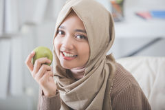 Attractive young woman eating apple. diet concept Royalty Free Stock Photography