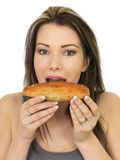 Attractive Young Woman Eating a Baked Cornish Pasty Royalty Free Stock Images