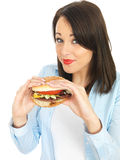 Attractive Young Woman Eating a Beef Burger Royalty Free Stock Photo