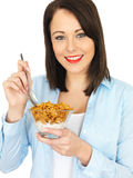Attractive Young Woman Eating Breakfast Cereals Royalty Free Stock Photos