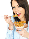 Attractive Young Woman Eating Breakfast Cereals Royalty Free Stock Image