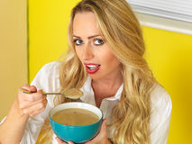 Attractive Young Woman Eating Chicken Soup Stock Photography