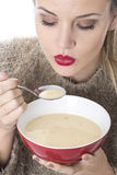 Attractive Young Woman Eating Chicken Soup Stock Images