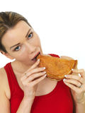 Attractive Young Woman Eating a Cooked Cornish Pasty Snack Royalty Free Stock Photos