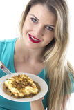 Attractive Young Woman Eating a Cottage Pie Royalty Free Stock Images