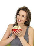 Attractive Young Woman Eating and Enjoying Popcorn Royalty Free Stock Photos