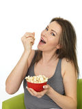 Attractive Young Woman Eating and Enjoying Popcorn Stock Photos