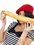 Attractive Young Woman Eating a French Stick Bread Loaf Royalty Free Stock Image