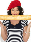 Attractive Young Woman Eating a French Stick Bread Loaf Royalty Free Stock Photography
