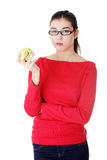 Attractive young woman eating green apple. Royalty Free Stock Images