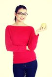 Attractive young woman eating green apple. Royalty Free Stock Photography