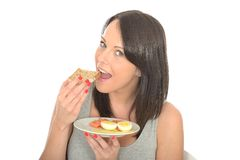Attractive Young Woman Eating a Healthy Norwegian Break Royalty Free Stock Photography