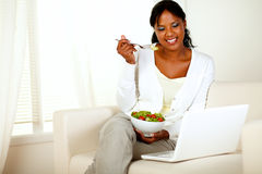 Attractive young woman eating healthy salad Royalty Free Stock Images