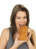 Attractive Young Woman Eating a Hot Cheese And Onion Slice Pastr Royalty Free Stock Images