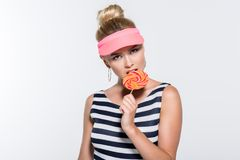 Attractive young woman eating lollipop Royalty Free Stock Photo