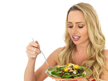 Attractive Young Woman Eating a Prawn Salad Stock Images