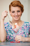 Attractive young woman eats ice cream outdoors Royalty Free Stock Photo