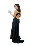 Attractive young woman in elegant black dress Royalty Free Stock Photos