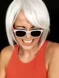 Attractive Young Woman Embarrassed Wearing Sunglasses Royalty Free Stock Photos