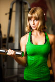 Attractive young woman is engaged in fitness sport club working Royalty Free Stock Images
