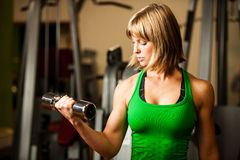 Attractive young woman is engaged in fitness sport club working Stock Photos