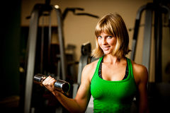 Attractive young woman is engaged in fitness sport club working Royalty Free Stock Image
