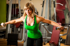 Attractive young woman is engaged in fitness sport club working Stock Image