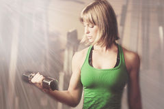 Attractive young woman is engaged in fitness sport club working Stock Images