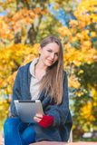 Attractive young woman enjoying an autumn day Royalty Free Stock Image