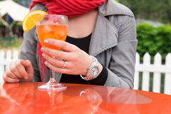 Attractive young woman enjoying cocktail in an outdoor bar Stock Image